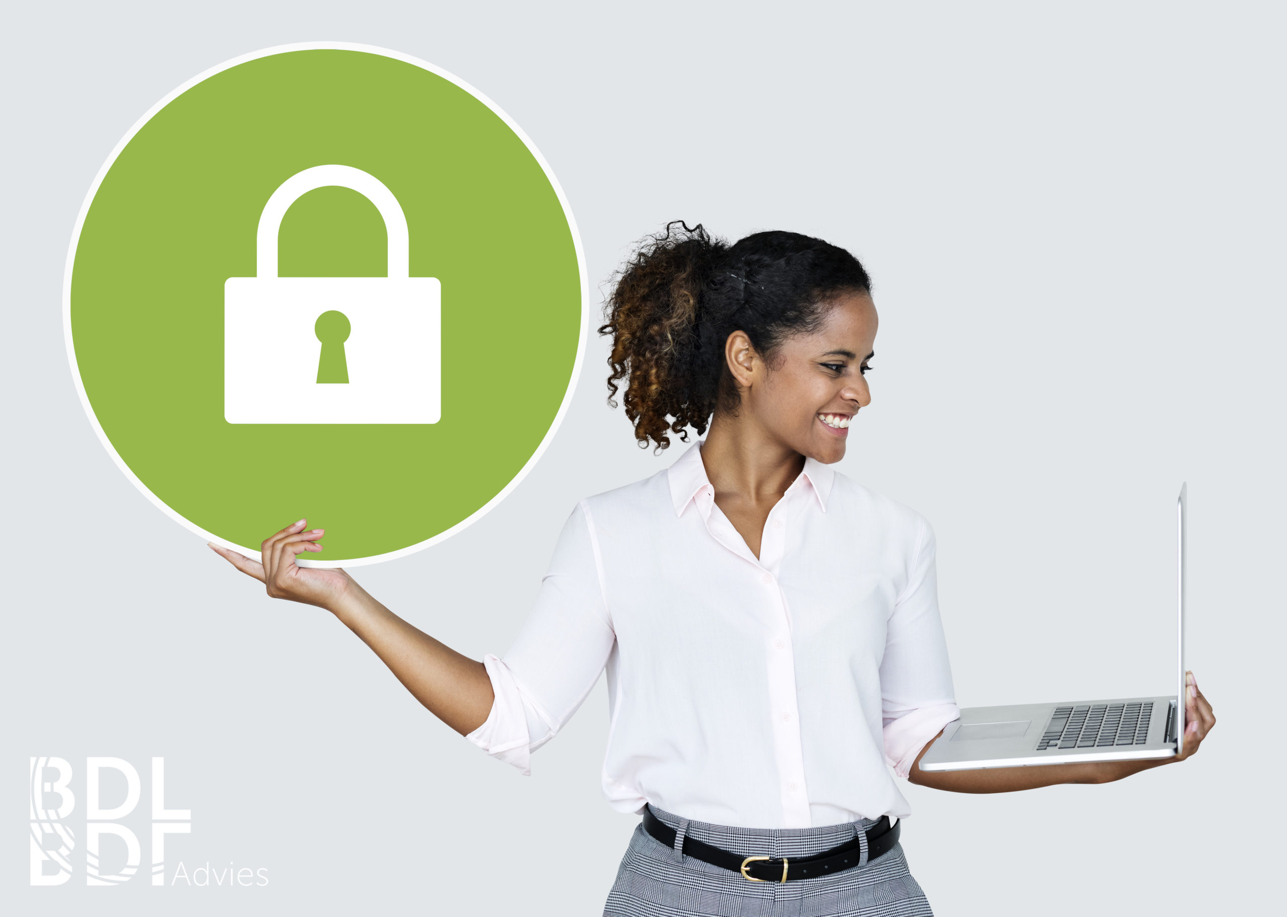 Woman holding a padlock and a laptop
